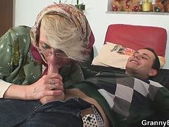 Horny granny sucks the young cock