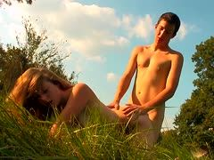 Young couple fucks in the meadow