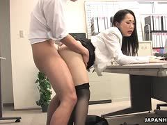 Japanese babe fucks in the office