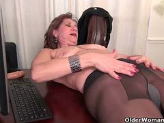 Old woman dildo fucks herself in the office
