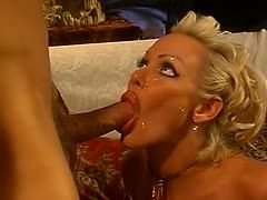 Blonde milf licks his cock clean after sex