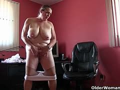 Fat granny sits with pantyhose in her office and masturbates