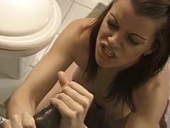 White babe wanks a bbc in the bathroom