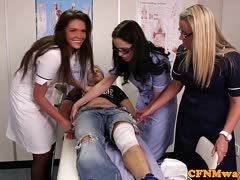 Three nurses suck a patient's cock