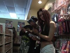 Cute hot teenie becomes horny in the sex shop