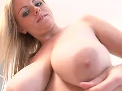 Sexy blonde with big tits strips