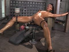Horny black is fucked by a machine